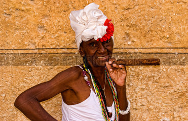 Portrait of local colorful woman with big cigar in Havana Cuba