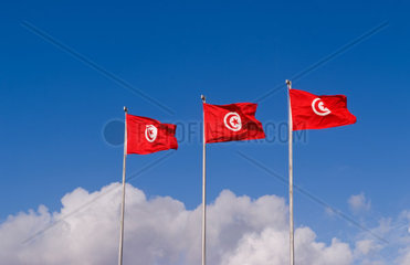Three Tunisia national flags flting at Tunis Airport in Northern Africa