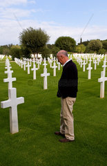 Veteran honoring graves at American Military Cemetery in Tunis Tunisia Africa where WWII heros rest