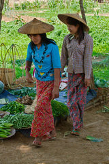 Young Burmese woman attend the YWAMA MARKET on the way to INDEIN  INLE LAKE  MYANMAR