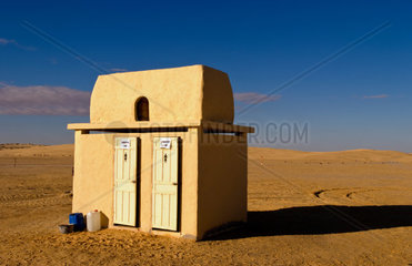 Toilets in the middle of nowhere at famous movie set of Star Wars movies in Sahara Desert near Tozeur Tunisia with his and hers