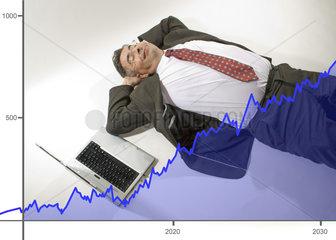 Aktienkurse Geschaeftmann ruht sich aus