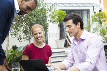 Businessman sharing ideas with colleagues