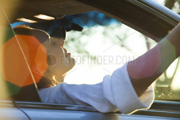 Woman passenger riding in car
