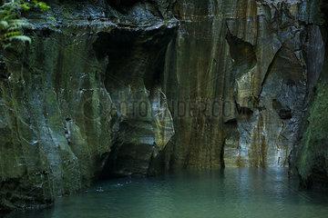 Lake at base of steep rock walls