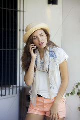 Young woman making phone call with cell phone