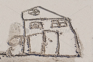 Drawing of house in sand