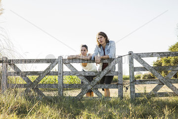 Young couple hanging out at farm