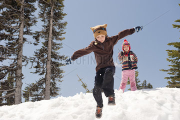 Boy jumping in snow