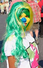 Germany. Berlin - brasilian football fan at a streetparty