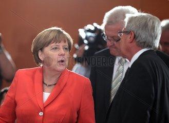 Angela Merkel mit Winfried Kretschmann und Jens Boehrnsen