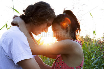 Young couple embracing  touching foreheads