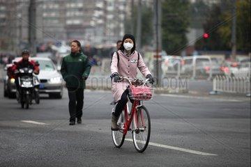Fahrradfahrerin in Peking