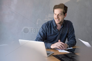 Man in office using laptop computer