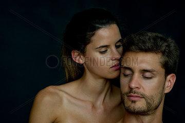 Woman nuzzling her boyfriend