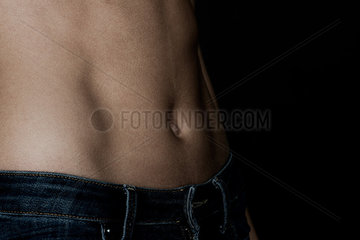 Close-up of woman's bare stomach