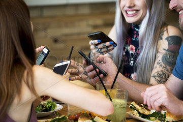 Friends all using smart phones