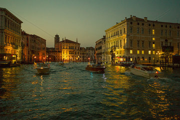 Boats travel on the Grand Canal in Venice  Italy  at dusk