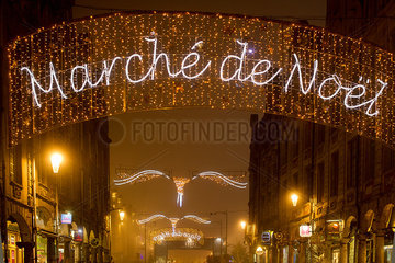 Illuminated sign advertising an outdoor Christmas market in Arras  France