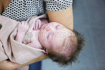 Mother holding new born baby