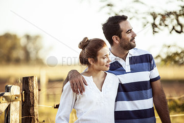 Couple admiring view of countryside