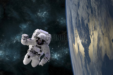 An astronaut floating above Earth.