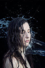 Portrait of a woman hit by water