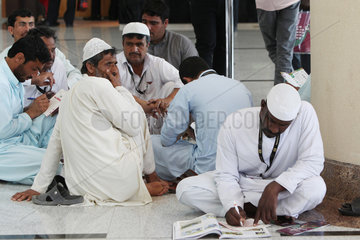 Dubai  Arabic men sitting inside the grandstand on the ground