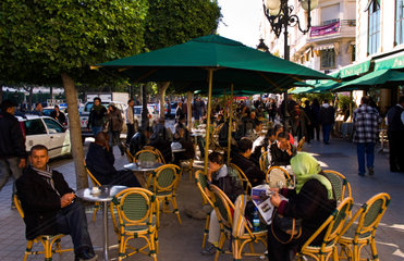 Street scenes on the busy Avenue Bourguiba in center of downtown with cafes