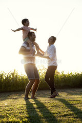 Family with little boy having fun at the park