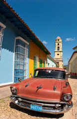 Old Classsic Chevy on cobblestone street of Trinidad Cuba