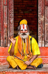 Religious Hindu costumed man in Durbar Square in center of village of Kathmandu Nepal
