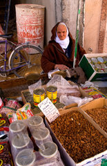 Old man selling nuts in market of the famous Medina in MUslim Holy City of Kairovan Tunisia Africa