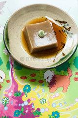 Goma dofu (tofu made from ground sesame paste and kudzu powder)  served with soy sauce and wasabi