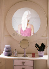 Woman reflected in mirror  rear view