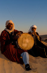 Bedouin men playing music in Sahara desert in Douz Tunisia Africa