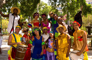 Colorful band playing in plaza park in central Havana Cuba with colorful costumes