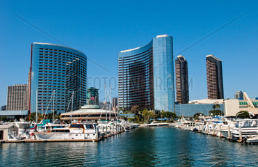 Seaport Village Marina in San Diego Bay in California with boats and ships in pier