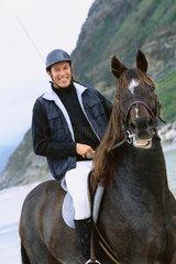 Man riding horse on beach  portrait