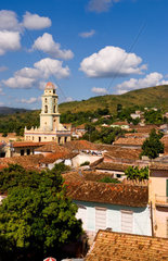 View from above with great clouds of the old Colonial village of Trinidad Cuba buildings