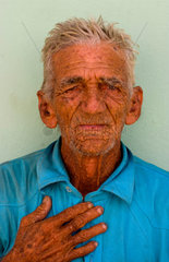 Old man with wrinkles portrait in old colonial village of Trinidad Cuba