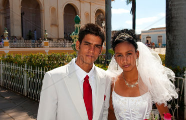 Young couple in wedding in park in Trinidad Cuba