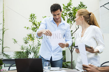 Business professionals reviewing documents