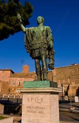 Historical Caesar bronze statue in Roman Forum in center of Rome Roma Italy Europe