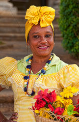 Colorful dancers in costume with flowers in Old Havana Habana Cuba