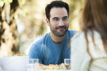 Man having meal outdoors with date