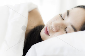 Woman sleeping in bed  close-up