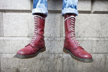 A pair of purple coloured Dr Martens boots.