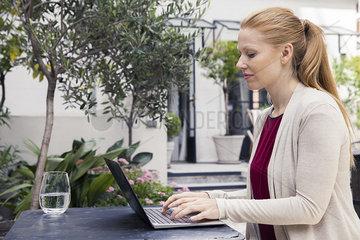 Writer using laptop computer outdoors