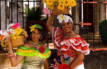 Portrait of smiling women with flower basket in downtown Havana Cuba